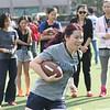 2014 NFL Home Field Shanghai - Week 4 - Participants join team-building clinics where they experience and learn the basics of American football.