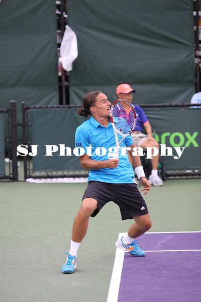 Alexandr Dologopokov (UKR) playing against Jarkko Nieminen (FIN) at the 2014 Sony Open Tennis in Miami, Florida at Crandon Tennis Park on March 22, 2014. Dologopokov defeated Nieminen in the 1st round, 6-0, 6-1.