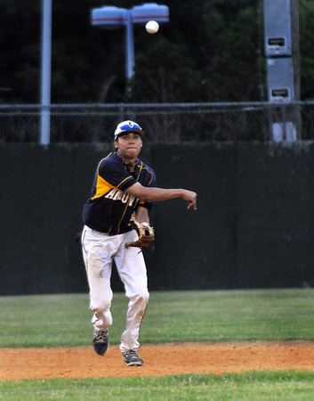 CARL RUSSO/Staff photo. Andover high defeated Waltham 11-4 in baseball tournament action Wednesday night. Andover's short stop, Juan Quelis makes the play and the throw to first base for the out. 6/4/2014.