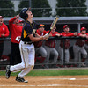 CARL RUSSO/Staff photo. Andover high defeated Waltham 11-4 in baseball tournament action Wednesday night. Andover's Quinn McCarthy watches his high pop-up before its caught for the out. 6/4/2014.