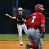 CARL RUSSO/Staff photo. Andover high defeated Waltham 11-4 in baseball tournament action Wednesday night. Andover's second baseman, Quinn McCarthy makes the play and the throw to first base for the out as Waltham's Nick Neshe sprints down the first base line. 6/4/2014.