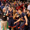 Central Catholic head coach Rick Nault celebrates with players including Tyler Nelson (11) as time expires in their 79-66 win over Catholic Memorial in the Division 1 State semifinals at the TD Garden in Boston.