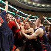 Central Catholic players celebrate with fans and teammates after their 79-66 win over Catholic Memorial in the Division 1 State semifinals at the TD Garden in Boston.