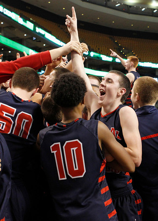 Central Catholic's Tyler Nelson, right, celebrates with fans and teammates after their 79-66 win.