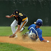 CARL RUSSO/Staff photo. Georgetown high defeated Boston International 12-1 in baseball tournament action on Wednesday. Georgetown's senior captain, Ben Noelk avoids being hit in the face by the bad throw as he steals second base. 6/4/2014.
