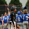 CARL RUSSO/Staff photo. NEWBURYPORT NEWS: Georgetown high defeated Boston International 12-1 in baseball tournament action on Wednesday. Georgetown players celebrate scoring another run. 6/4/2014.