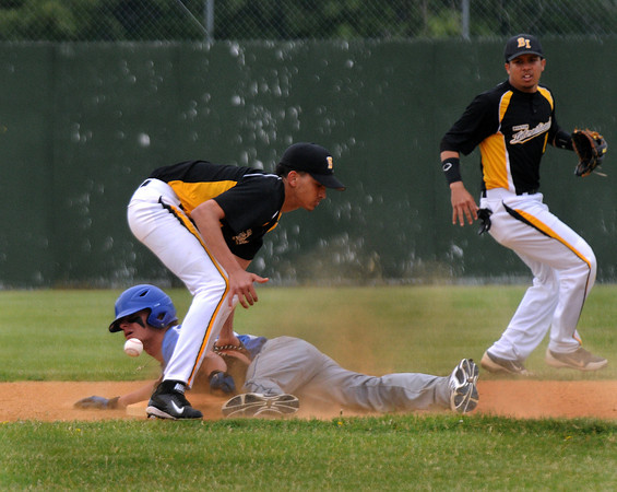 CARL RUSSO/Staff photo. NEWBURYPORT NEWS: Georgetown high defeated Boston International 12-1 in baseball tournament action on Wednesday. Georgetown's Michael Goddu is safe stealing second base as Boston International's Angel Troncoso tries to handle the throw. 6/4/2014.