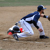 North Andover's Stephen Borzi is tagged out by Lawrence's Ignacia Cepedez sliding into third base in Friday baseball action against Lawrence. 4/11/2014.