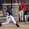 Lawrence's Ignacio Cepedez foul tips the ball back in Friday baseball action against Lawrence. 4/11/2014.