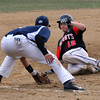 North Andover's William Marcotte is safe sliding into third base after Lawrence's third baseman, Ignacio Cepedez drops the ball after the tag in Friday baseball action. 4/11/2014.