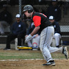 North Andover's Jake Caporale sprints to first on a base hit in Friday baseball action against Lawrence. 4/11/2014.