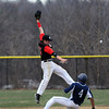 Lawrence's Darluigi Gonzalez is safe sliding into second base as North Andover's Stephen Borzi attempts to catch the over thrown ball.  4/11/2014.