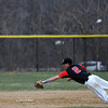 North Andover's short stop, captain Matthew Varoutsos, 2, reaches out towards Lawrence's Elvis Peralta to tage him out at second base in Friday baseball action. Varoutsos caught the high throw, leaped over a sliding Peralta and still managed to tag Peralta out after he past the bag. 4/11/2014.