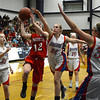 RYAN HUTTON/ Staff photo.   <br /> Pinkerton's Andera Albrecht (12) tries to put up a shot over the defense of Londonderry's Talyor Collins (20) and Casey Evans (33) during the first half of Thursday night's game.