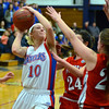 RYAN HUTTON/ Staff photo.  <br /> Londonderry's Aliza Simpson (10) tries to put up a shot over the heads of Pinkerton defenders during the first half of Thursday night's game.