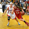 RYAN HUTTON/ Staff photo.  <br /> Pinkerton's Colleen Fortier (23) drives past Londonderry's Aliza Simpson (10) during the fourth period of Thursday night's game.