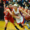 RYAN HUTTON/ Staff photo.  <br /> Londonderry's Aliza Simpson (10) drives past Pinkerton's Brandi Bonneau (24) during the first half of Thursday night's game.