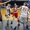 RYAN HUTTON/ Staff photo.  <br /> Pinkerton's Melissa Martel (10) finds herself surrounded by Londonderry defenders  Jordan Marett (22) Brittany Roche (31) and Casey Evans (33) during the fourth period of Thursday night's game.
