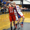 RYAN HUTTON/ Staff photo.  <br /> Pinkerton's Melissa Martel (10) and Londonderry's Jaclyn Luckhardt (14) both reach for a rebound during the fourth period of Thursday night's game.