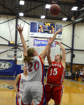 RYAN HUTTON/ Staff photo.  <br /> Londonderry's Taylor Collins (20) blocks a shot by Pinkerton's Kayla Stacy (15) during the first half of Thursday night's game.