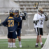 Andover's Zach Walker (23) is congratulated by teammate Andy Soucy after scoring a goal against Haverhill including defender George Scopelites during their lacrosse game at Trinity Stadium in Haverhill.
