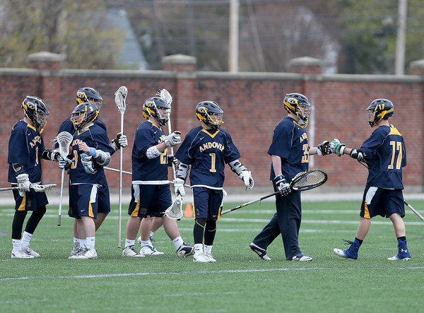 Andover players celebrate their win over Haverhill after their lacrosse game.