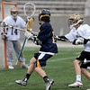 Andover's Jake Lakos eyes the goal with Haverhill's Owen Kallery defending as goalie Zach Grundy guards.