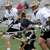 Andover's Hunter Tyrrell races past Haverhill defender George Scopelites and midfielder Tyler Gibbs.