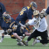 Andover's Will Reardon and Haverhill's John Papachriston collide in pursuit of the ball during their lacrosse game.