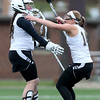 Haverhill's Jamie Martel, right, runs to congratulate goalie Alex Comeau after holding on for the win against Methuen.