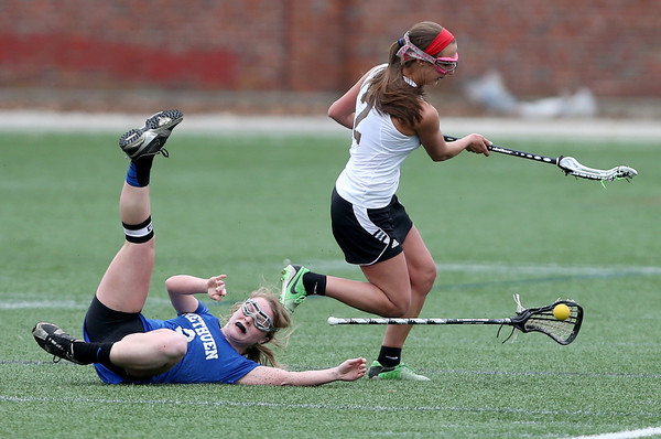 Methuen's Shaley Horan loses her stick and the ball as she falls to the turf during a collision with Haverhill's Abby Nauffts during their lacrosse game at Trinity Stadium in Haverhill.   Methuen mounted a comeback, but Haverhill held on for the win.