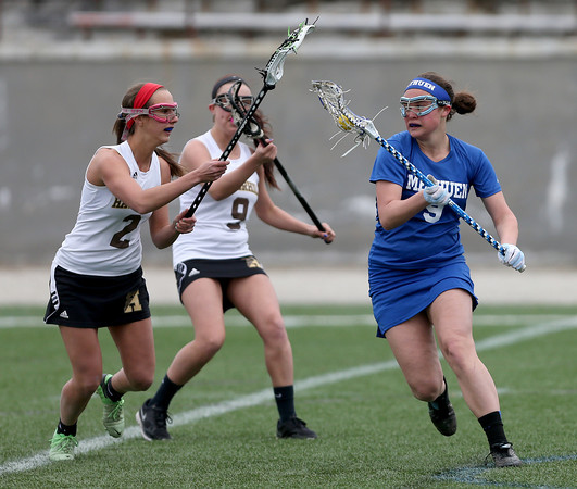 Methuen's Aryanna Poirier carries the ball up the turf against the defense of Haverhill's Abby Nauffts (2) and Julia Rankin (9).