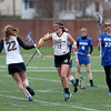 Haverhill's Emily Schultz congratulates teammate Holly Periera (12) after scoring a goal as Methuen's Lauren Arsenault looks on.