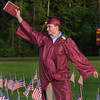 CARL RUSSO/Staff photo. GAZETTE: Whittier graduate, Jacob Fraser of Haverhill waves to his family after receiving his diploma during the Whittier Regional Vocational Technical High School graduation ceremony Thursday night. 5/29/2014.