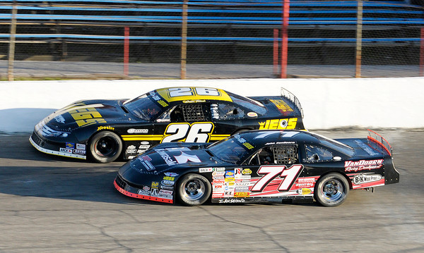 Don Knight   The Herald Bulletin<br /> Johnny VanDoorn (71) takes the lead from Bubba Pollard (26) during the first half of the Stoops Freightliner Redbud 300 at the Anderson Speedway on Saturday.