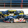 Don Knight | The Herald Bulletin<br /> Johnny VanDoorn (71) takes the lead from Bubba Pollard (26) during the first half of the Stoops Freightliner Redbud 300 at the Anderson Speedway on Saturday.