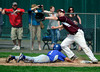 5/10/2014 Mike Orazzi | Staff<br /> Bristol Eastern's Jake Colello (1) dives back to first as Bristol Central's Jacob Hall (17) lunges for the ball at Muzzy Field Saturday.
