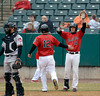 4/4/2014 Mike Orazzi | Staff<br /> Rock Cats Nate Hanson (12) and Brad Boyer (4) during Friday's game with the Richmond Flying Squirrels in New Britain.