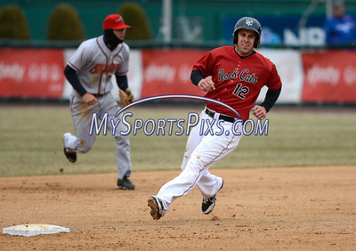 4/4/2014 Mike Orazzi | Staff Rock Cats Nate Hanson (12) rounds second during Friday's game with the Richmond Flying Squirrels in New Britain.