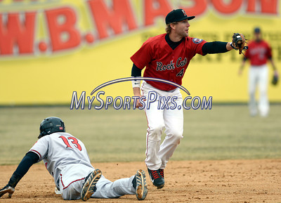 4/4/2014 Mike Orazzi | Staff Rock Cat's Brad Boyer (4) forces out the Richmond Flying Squirrels' Kelby Tomlinson (13) in New Britain Friday.