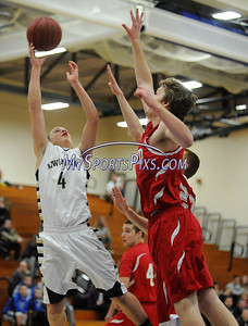2/19/2014 Mike Orazzi | Staff Newington's Zachary Tinkham (4) and Conard's William Simons (43) at NHS on Wednesday night.