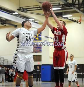 2/19/2014 Mike Orazzi | Staff Newington's Marcus Guadarrama  (24) and Conard's Aidan Maloney (23) at NHS on Wednesday night.