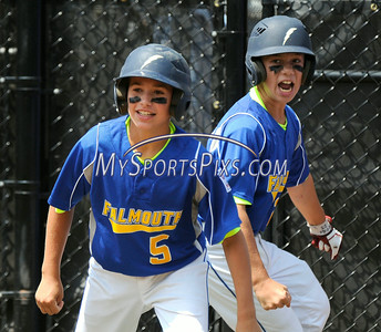 8/6/2014 Mike Orazzi | Staff Maine's Carson James (5) and Nathan Rogers (23) after scoring during the Eastern Regional Little League Tournament on Tuesday in Bristol.