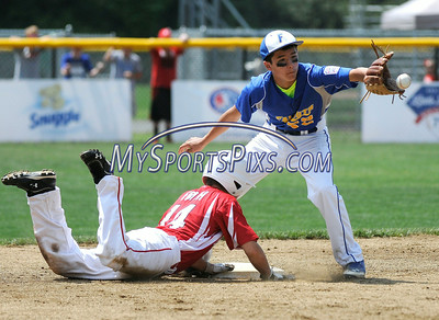 8/6/2014 Mike Orazzi | Staff Maine's Joshua LeFevre (22) as Mass' Brian Frieh (14) dives back to second during the Eastern Regional Little League Tournament on Tuesday in Bristol.
