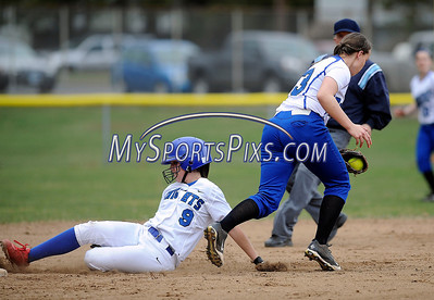 4/11/2014 Mike Orazzi | Staff Bristol Eastern's Charline Plasczynski  (13) as Southington's Kaitlin Paterson (9) steals second during Friday's softball game with Southington.
