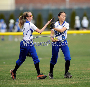4/11/2014 Mike Orazzi | Staff Bristol Eastern's Makenzie Jankowski (1) congratulates  Bailey Wyrebek (9) after she made  a catch during Friday's softball game with Southington.