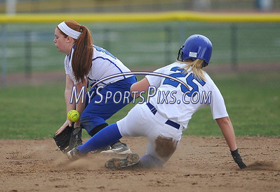 4/11/2014 Mike Orazzi | Staff Southington's Rachel Dube (25) slides into second as Bristol Eastern's Nicole D'Amato takes the throw during Friday's softball game at SHS.