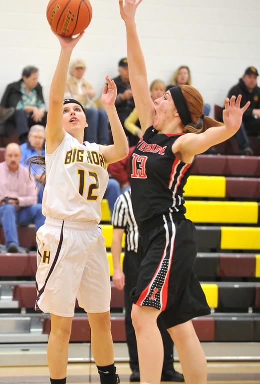 Cassidy Enloe shoots over a Riverside shot blocker Thursday at Big Horn High School. Mike Pruden | The Sheridan Press