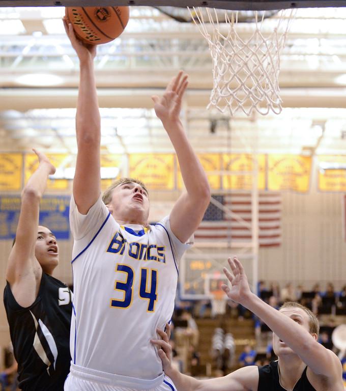 Sheridan Bronc Blake Baker puts up a shot against Cheyenne South during the game Friday at Sheridan High School. Justin Sheely | The Sheridan Press.