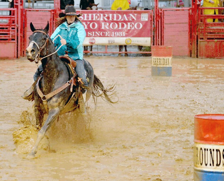 Sheridan's Gabrielle Koltiska and her horse splash through barrell racing course Sunday at the Sheridan County Fairgrounds. Mike Pruden | The Sheridan Press